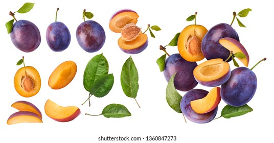 Set with different Flying in air fresh ripe whole and cut Plums with leavs isolated on white background. High resolution image