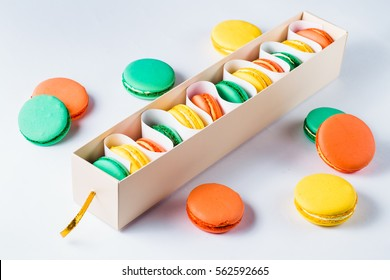 Set of different french cookies macaroons in a paper box.