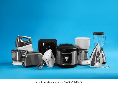 Set of different household appliances on light blue background