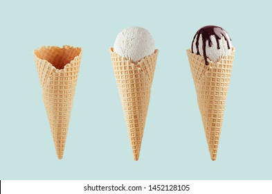 Set of different ice cream cones in waffle cone - empty, white ice cream, with chocolate sauce on  green background.