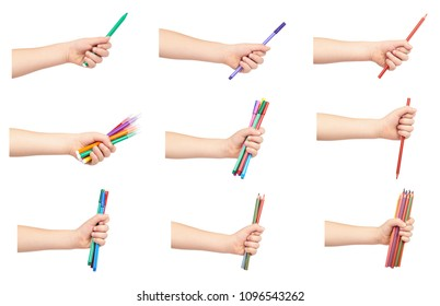 set of different Kid hand hold color felt pens and pencils with hand, isolated on white background.