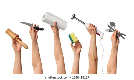 set of the different kitchen equipment in hands, on white background