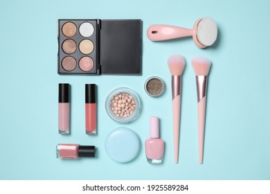 Set of different makeup products on turquoise background, flat lay