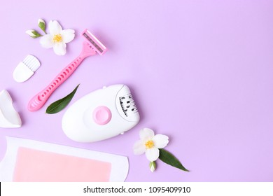 a set of different means for epilation on a colored background. Removal of unwanted hair. Modern epilator, wax strips, razor. Minimalism, top view. flatlay