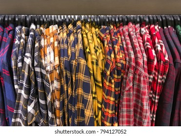 Set of different men mens colorful cotton plaid shirts,clothes on hangers in store