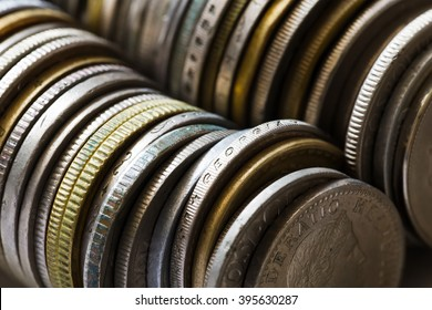 set of different metal coins stacked column
