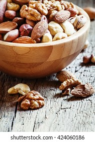 Set of different nuts, useful healthy food, vintage wooden background, selective focus