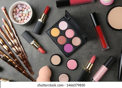 Set of different professional makeup products on table, flat lay