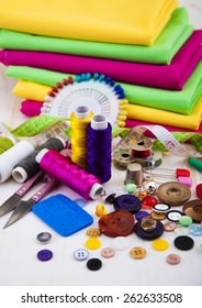Set of different sewing accessories,fabrics and thread spools
