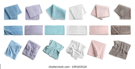 Set of different soft terry towels on white background, top view
