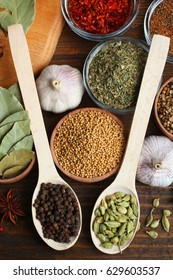 Set of different spices on a wooden background