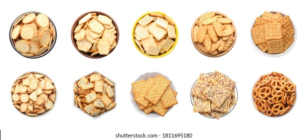 Set of different tasty crackers in bowls on white background, top view