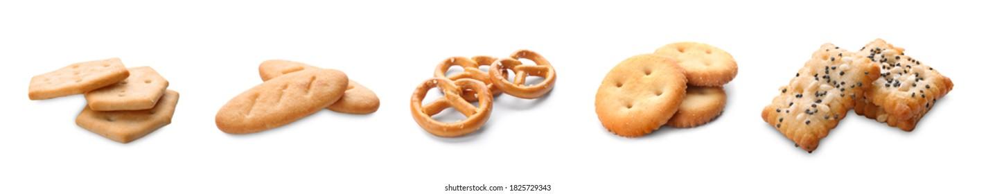 Set of different tasty crispy crackers on white background, banner design