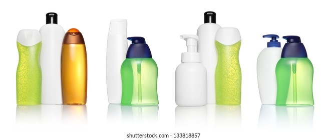 Set of different white, orange, green, blue bottles for beauty, hygiene and health on a white background with reflection, they shampoo, conditioner and hair products, each of them shot on separately.