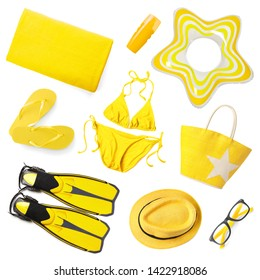 Set of different yellow beach accessories on white background, top view