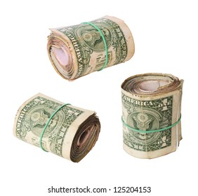 set of dirty rolls of United States dollars isolated white