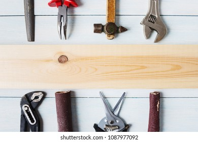 Set of diy tools and blank wooden plate with copy space.