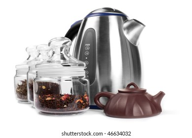 Set for drinking tea: tea in containers, metal kettle, yixing clay teapot  isolated on white.
