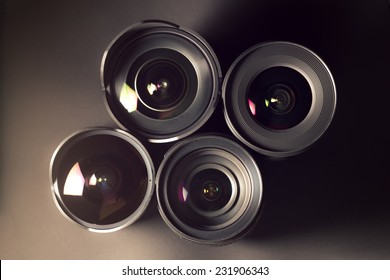 Set of DSLR lenses, different sizes and reflections.