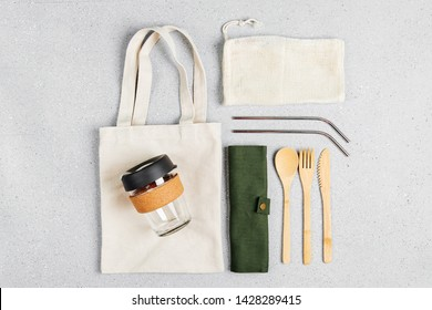 Set of Eco friendly bamboo cutlery, eco bag and reusable coffee mug. Sustainable lifestyle. Plastic free concept.