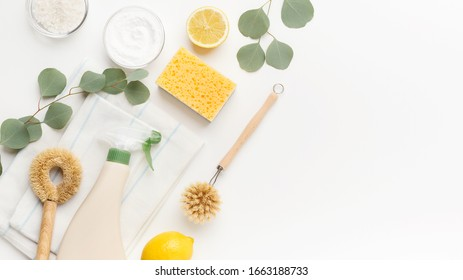 Set of eco friendly natural cleaning products, bamboo brush, lemon, baking soda, spray bottle on white background, copy space, panorama. Zero waste lifestyle