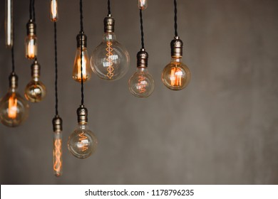 Set edison retro lamp on loft gray concrete background. Concept idea