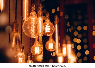 Set edison retro lamp on dark bokeh background of different shapes.