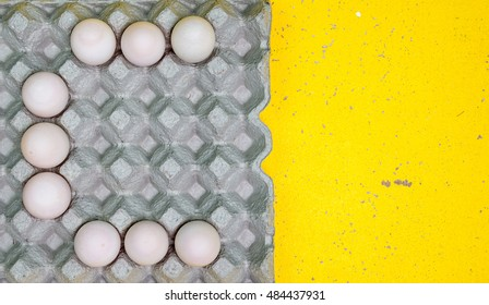 Set of eggs alphabet a - z show by duck eggs in paper tray on wooden Background