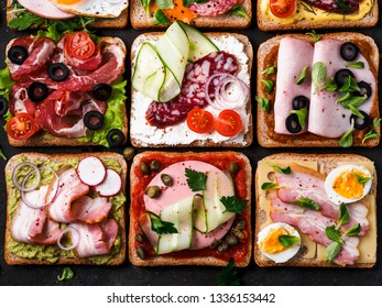 Set of eight different sandwiches with meat in square shape. Top view or flat lay. Assortment meat toasts on black background. Idea, creative concept for sausage maker
