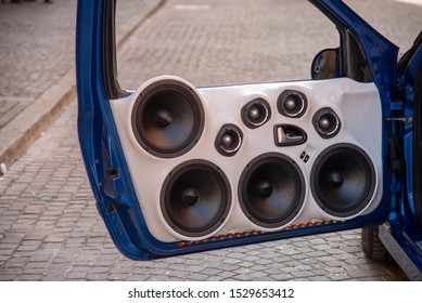 Set of eight speakers installed on a car door. Custom cars with large car stereo system speakers to the car show.