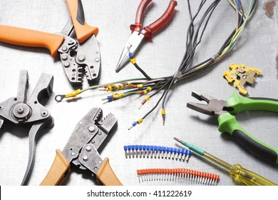 Set of electrical tool on wooden background. Accessories for engineering work, energy concept.