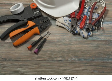 Set of electrical tools on wooden background. Accessories for engineering work, energy concept