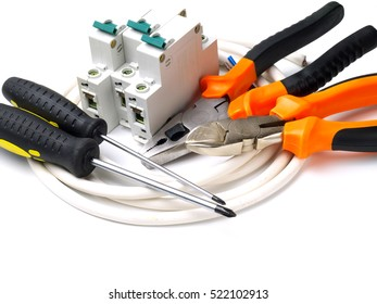 set of electrician tools and equipment and a coil of wire on a white background, focus on cutter
