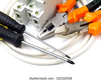 set of electrician tools and equipment and a coil of wire on a white background, closeup, focus on cutter