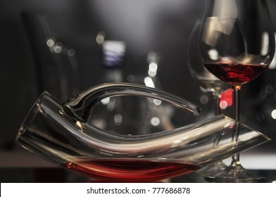 A set of elegant decanter and glasses filled with red wine