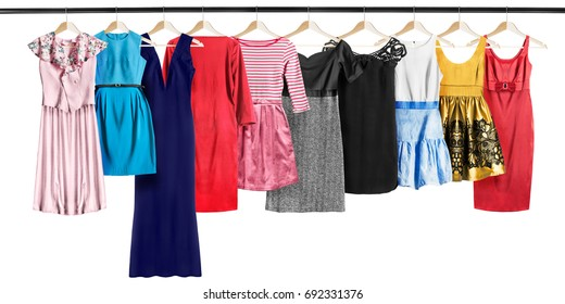 Set of elegant dresses hanging on clothes racks isolated over white