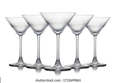 Set of empty martini glasses isolated on white background.