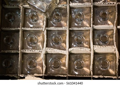 Set of Empty small  transparent bottles in a box