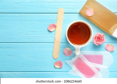 Set for epilation on wooden background, flat lay