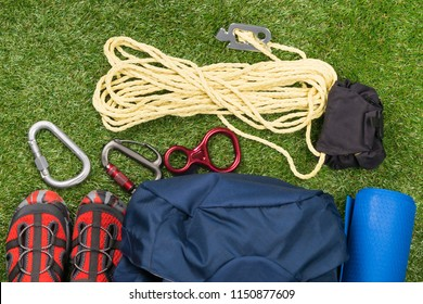 set of equipment and shoes for travel and adventure in the mountains