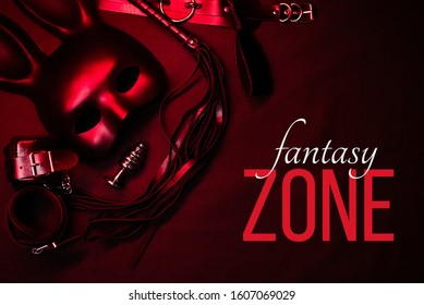 set of erotic sex toys for sex with submission and domination and role-playing games. Text Fantasy Zone