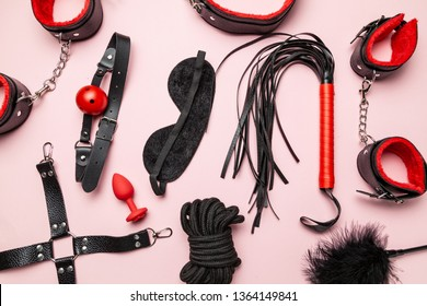 Set of erotic toys for BDSM. The game of sexual slavery with a whip, gag and leather blindfold. Intimate sex games