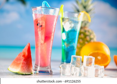 Set of exotic drinks on the beach with blue ocean background