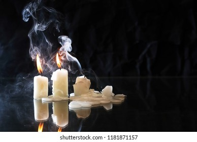 Set of extinguished candles with fire and smoke on nice dark background
