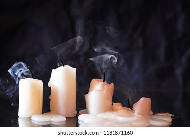 Set of extinguished candles on nice dark background
