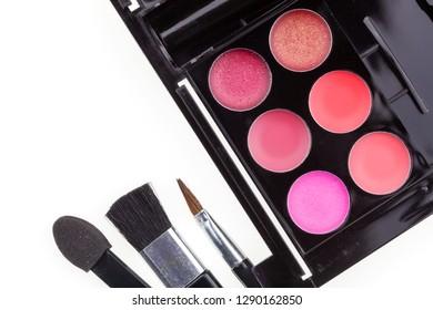 Set of eyeshadow and blush isolated on white background.
