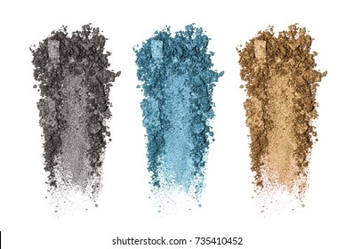 Set of eyeshadow sample isolated on white background. Crushed brown (golgen), black and blue metallic eyeshadow. Closeup of a makeup product.