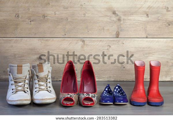 Set of familie shoes standing in line
