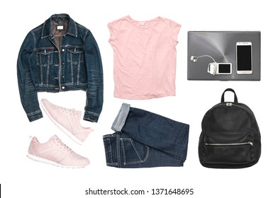 Set of fashionable clothing and accessories isolated on white background. Denim jacket, jeans, pink sneakers, black leather backpack, t shirt, laptop, player and phone. Casual style