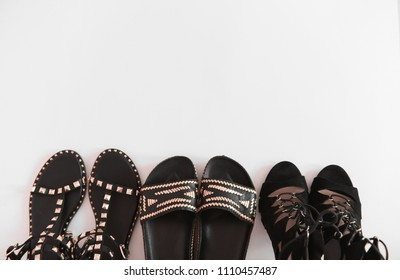 A set of fashionable luxury women's sandals in black on a white background. The concept of fashion blog and shopping.